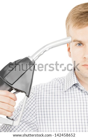 Male pointing black color fuel pump nozzle at his head - stock photo