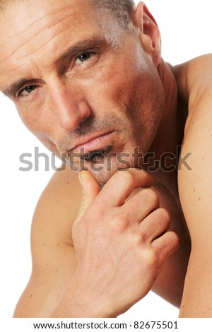 Male portrait, close-up against a white background. - stock photo