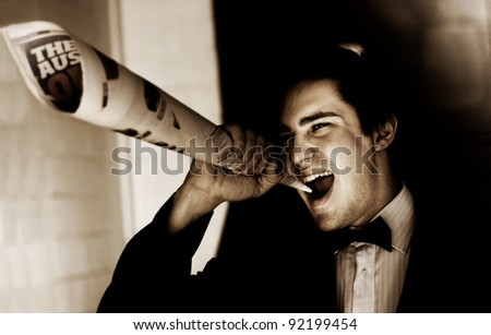 Male Reporter Or Journalist Shouting Yelling And Screaming Out The End Of A Newspaper While Making A Press Release Announcement On An Informative News Update - stock photo