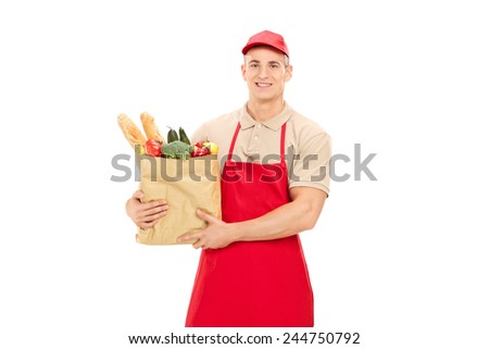 Male retail worker holding a grocery bag isolated on white background - stock photo