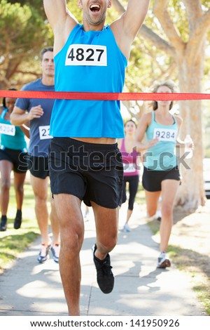 Male Runner Winning Marathon