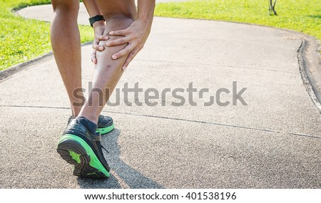 Male runner with muscle pain in right leg, Leg calf sport muscle injury - stock photo
