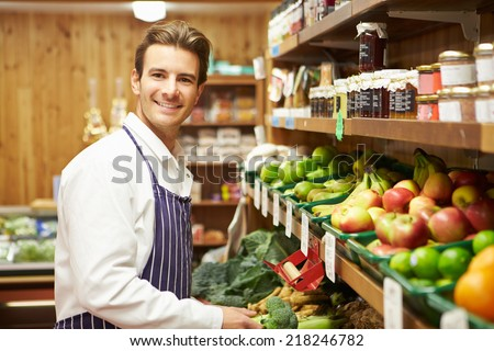 sales assistant stock photos  royalty free images  amp  vectors    male sales assistant at vegetable counter of farm shop