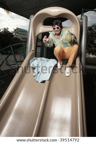 Male scared to go down the slide