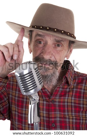 male senior country singer with microphone and cowboy hat