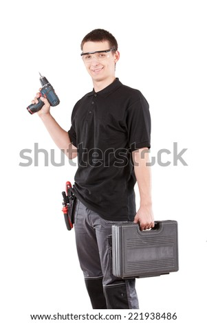 Male serviceman with toolbox and power drill. - stock photo
