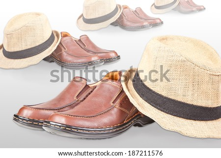 Male shoes and hats isolated on white - stock photo