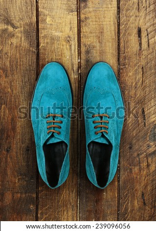 male shoes on a brown wooden background - stock photo