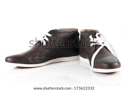 Male shoes over white