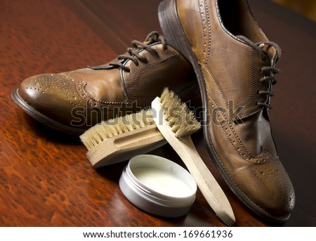 Male shoes with shoemaker tools