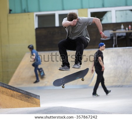 Male skater jumping high in the air - stock photo
