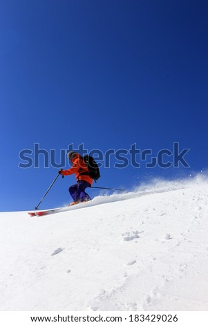 Male skier with blue sky background, Utah, USA. - stock photo