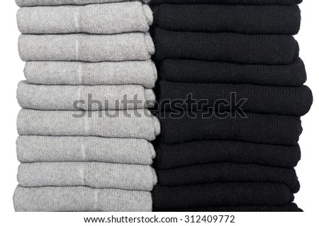 male socks neatly folded in a pile isolated on a white