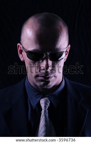 Male spy dressed in black - stock photo