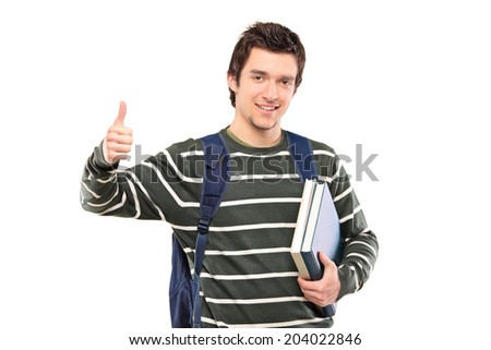 Male student holding books and giving a thumb up isolated on white background - stock photo