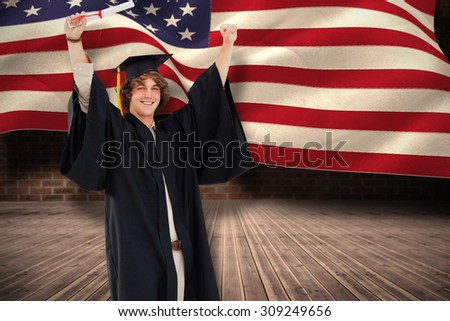 Male student in graduate robe raising his arms against composite image of digitally generated united states national flag