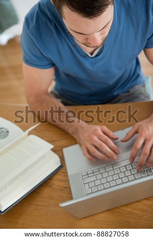 Male student looking for information on the internet - stock photo