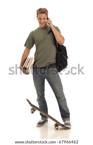 Male student on cell phone with books and skateboard