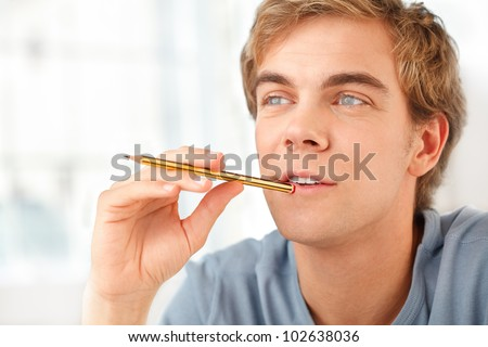 Male student preparing for exams at home - stock photo