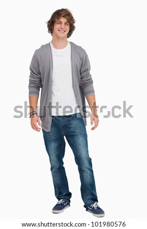 Male student standing against white background