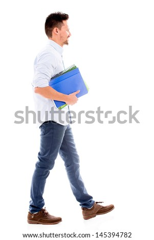 Male student walking and holding notebooks - isolated over white background - stock photo