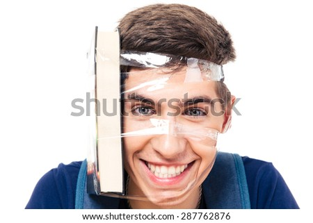 Male student with book strapped to his head isolated on a white background. Looking at camera - stock photo