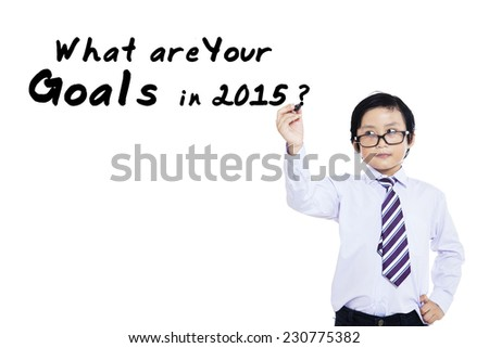 Male student writes a question for business goals in 2015, isolated over white background