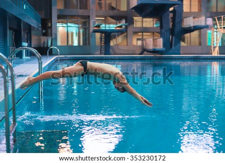 Male swimmer at the swimming pool - stock photo