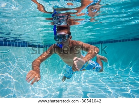 Male Swimmer in Pool Underwater - stock photo