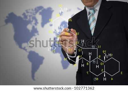Male Teacher write science formula - stock photo