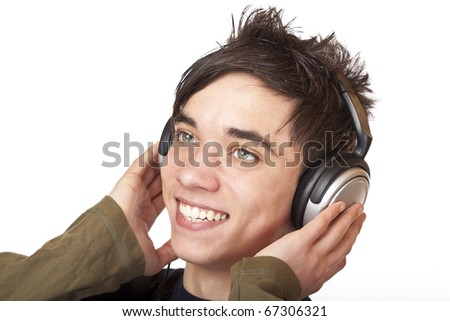 Male Teenager listening to music via headphone and sings. Isolated on white background. - stock photo