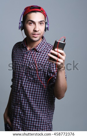 male teenager with headphones in the studio, the concept of music and technology