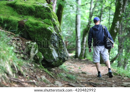 Male tourist in a spring forest