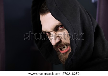 Male vampire ready to attack and eat blood - stock photo