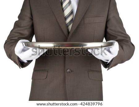 Male waiter holding tray isolated on white background - stock photo
