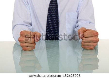 Male with fists on the table - stock photo