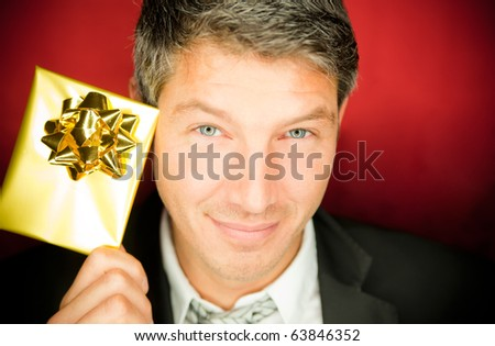 Male with golden voucher present - stock photo