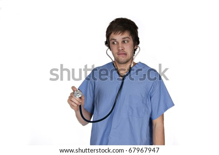 male with stethoscope on making a funny face on white background - stock photo