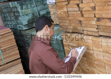 Male worker in the warehouse - stock photo