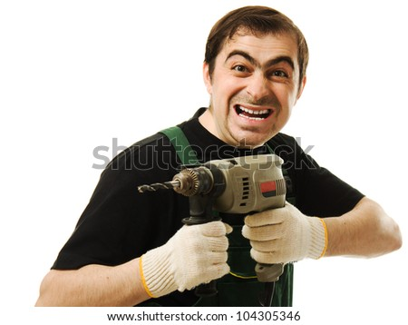Male worker with an electric drill on a white background - stock photo