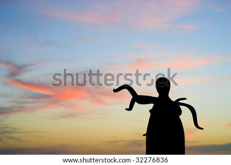 Malecon boardwalk strange statue in Puerto Vallarta Mexico - stock photo