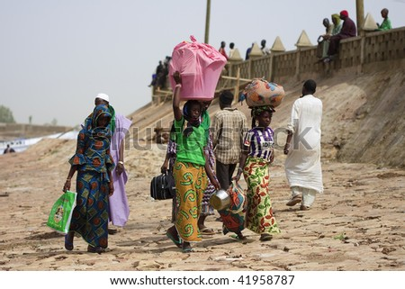 MALI - AUGUST 16: People in the port of Mopti, Niger River is the main artery through which passengers and freight moving, August 16, 2009 in Mopti, Mali - stock photo