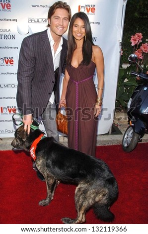 "MALIBU, CA - AUGUST 05: Eric Winter and Roselyn Sanchez at ""Bow Wow Ciao"" to Benefit Much Love Animal Rescue on August 05, 2006 at John Paul and Eloise Dejoria Estate in Malibu, CA. - stock photo"