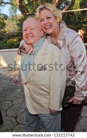 "MALIBU, CA - AUGUST 05: Mickey Rooney and wife Jan at ""Bow Wow Ciao"" to Benefit Much Love Animal Rescue on August 05, 2006 at John Paul and Eloise Dejoria Estate in Malibu, CA. - stock photo"