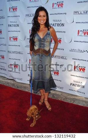 "MALIBU, CA - AUGUST 05: Tia Carrere at ""Bow Wow Ciao"" to Benefit Much Love Animal Rescue on August 05, 2006 at John Paul and Eloise Dejoria Estate in Malibu, CA. - stock photo"