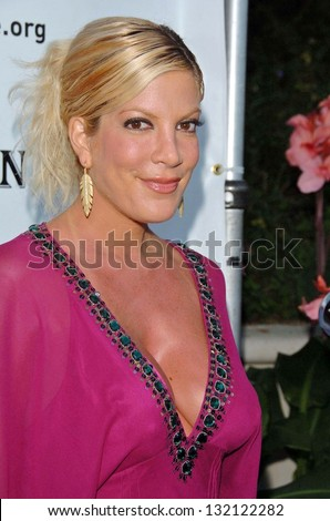 "MALIBU, CA - AUGUST 05: Tori Spelling at ""Bow Wow Ciao"" to Benefit Much Love Animal Rescue on August 05, 2006 at John Paul and Eloise Dejoria Estate in Malibu, CA. - stock photo"