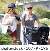 MALIBU - JUN 10: Jillian Michaels, Heidi Rhoades, son Phoenix, daughter Lukensia out for a stroll on June 10, 2012 in Malibu, California - stock photo
