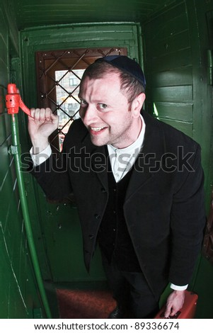 malicious person pulling emergency brake in train - stock photo