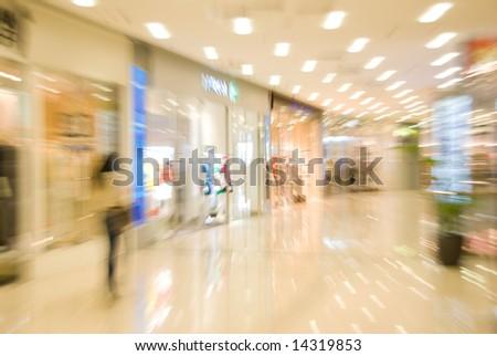 Mall interior. Blurred motion image - stock photo