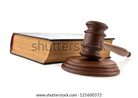 mallet and book on a white background - stock photo